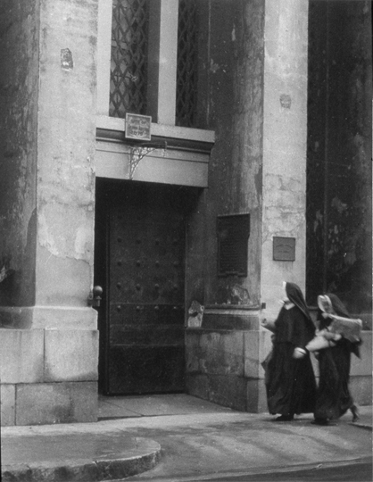 """Nuns walking in front of the Arsenal"""
