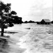 An Acadian-style house inundated by flood waters during 1927 flood