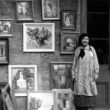 Alberta Kinsey with her paintings on exhibit at Pirate's Alley, in New Orleans.