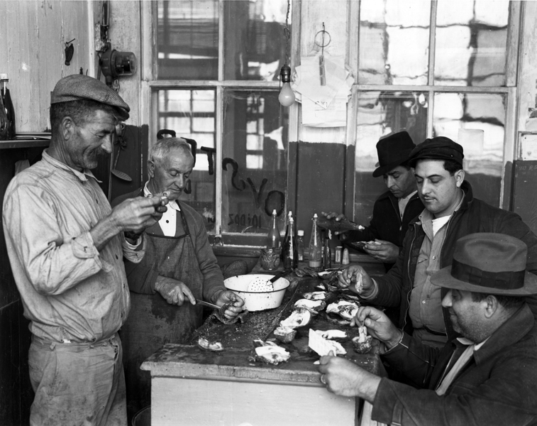 """""""Men eating oysters at waterfront bar in Morgan City, Louisiana in 1938"""" by Fonville Winans"""