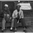 Negro musicians playing accordion and washboard in front of store, near New Iberia, Louisiana