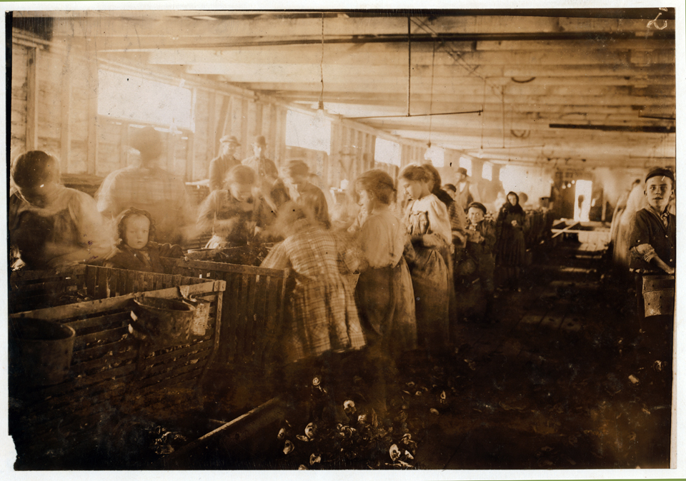 """Oyster shuckers in Dunbar Cannery"" by Lewis Wickes Hine"
