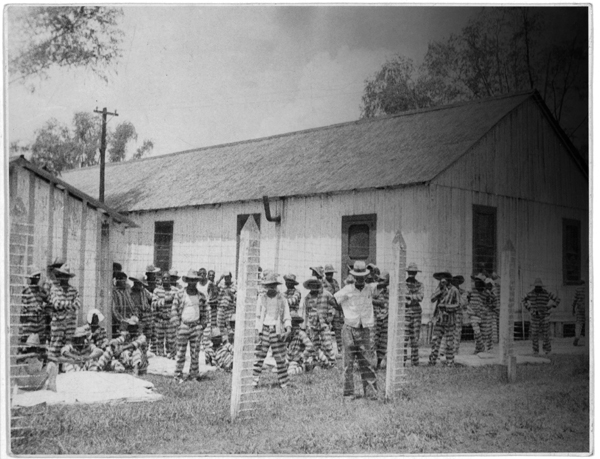 Prison compound No. 1, Angola, Louisiana. Lead Belly (Huddie Ledbetter) in the foreground.