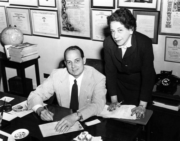 Mayor DeLesseps Morrison and woman in office