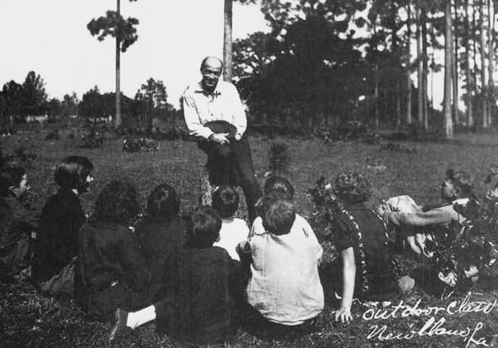 Education was of primary importace to the colony. Vocational instruction was stressed, and students were encouraged to offer alternative positions, even if they differed with the teacher's. Here students meet at an outdoor classroom.