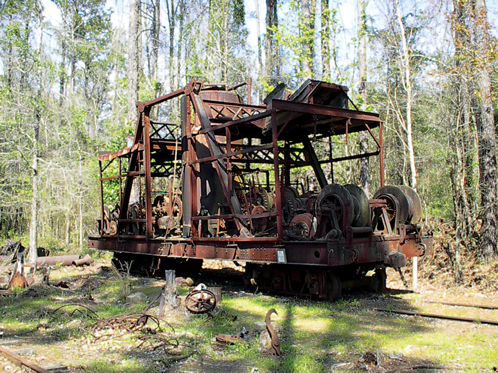 This 1919 Clyde Rehaul skidder, the last surviving machine of its kind in the world, exists today at Long Leaf without its booms. Enough booms are present on the site to enable a complete reconstruction. Courtesy of Southern Forest Heritage Museum, Photo by Everett Lueck.