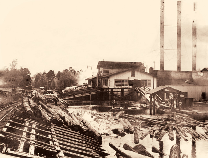 The Crowell and Spencer sawmill at Long Leaf  as it appeared in the 1930s with a log pond and dump track in the foreground. Courtesy of Southern Forest Heritage Museum, Crowell Family Collection.
