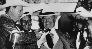 Former governor and country crooner Jimmie Davis clowns with then governor Earl Long on the campaign trail in 1959. Photo by Jack Arnham.