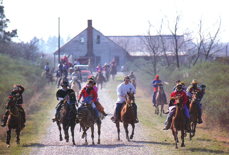 "Mardi Gras runners charge chosen farmsteads as soon as their capitaine has been granted permission from the homeowner. As the day wearson many runners are relegated to pickup trucks due to ""drunk riding."""