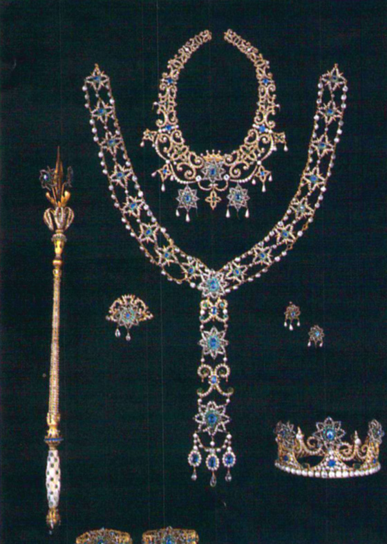 As Queen of Carnival in 1901, Bessie Merrick wore this complete parure, including crown, scepter, necklace, girdle, earrings, bracelets and brooch marked with the year of her reign.