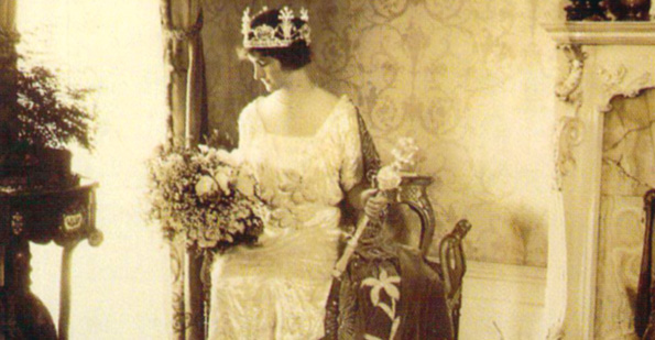 Elinor Bright, Queen of Carnival in 1920, shows off the short-lived fashion for Mardi Gras queens' dresses of raised hemlines. Louisiana State Museum