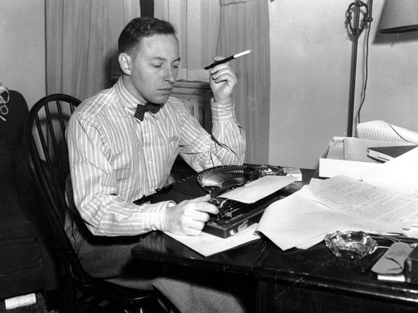 Tennessee William seated at his typewriter, 1945. courtesy the Library of Congress