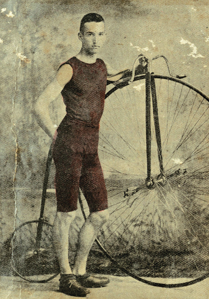 A cyclist poses with a penny-farthing, also known as a highwheel. Courtesy of the Historic New Orleans Collection.