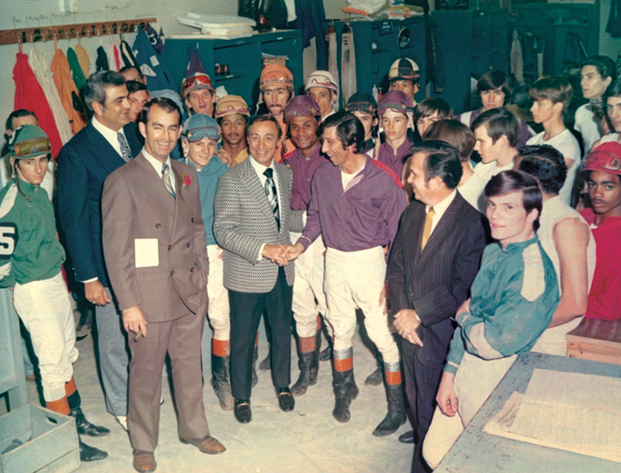 Evangeline Downs Director of Racing Charles Ashy (2nd from left) and Norman Faulk introduce retired jockey Eddie Acaro, one of the greatest jockeys in the history of American thoroughbred racing. Courtesy of the Collection of Charles Ashy