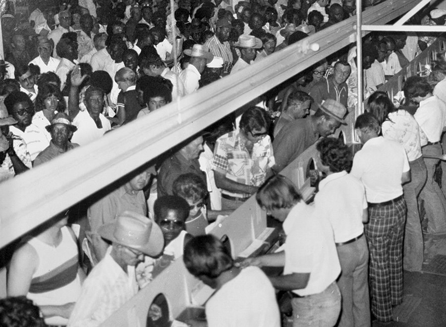 Racing fans visit the para-mutual windows on race day. The track drew gamblers from Mississippi, Alabama, and Texas who placed bets, dined in the clubhouse, and stayed in area hotels. Courtesy of the Bob Henderson Collection, Dupre Library, University of Louisiana, Lafayette