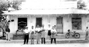Frank Morris (in the apron and visor) standing in front of his shoe shop in Ferriday, La., during the 1950s. Courtesy of Concordia Sentinel/William Brown