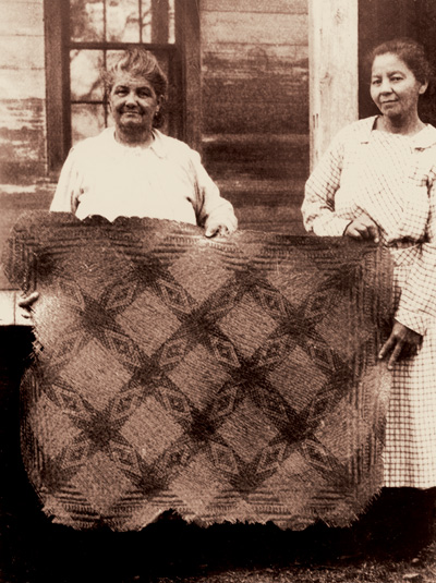 Chitimacha weavers Christine and Pauline Paul with a rivercane mat, Little Trout design, ca. 1930. Courtesy of Cammie G. Henry Research Center, Northwestern State University of Louisiana.