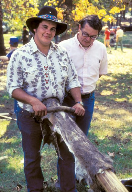 George Allen of the Jena Band of Choctaw Indians graining deerskin, ca. 1975. Courtesy of Northwestern State University, Gregory Collection.