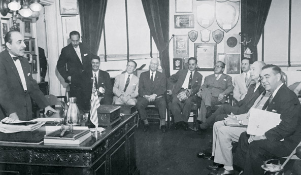Councilman Victor Schiro receving members of the Cuban delegation at City Hall during a trip to New Orleans in 1956. Courtesy of International Trade Mart