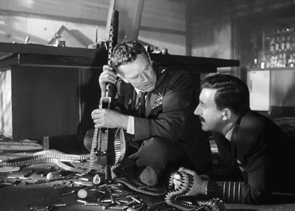 "In this scene from Dr. Strangelove or: How I Learned to Stop Worrying and Love the Bomb, Ripper tells Mandrake that he discovered the Communist plot to pollute Americans' ""precious bodily fluids"" during ""the physical act of love."" Courtesy of Columbia Pictures"