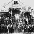 One-hundred members of Kenner's Italian community positioned in front of the Italian Social Club on Hanson Street, Kenner, ca. 1900s.  Courtesy of Louis Congemi