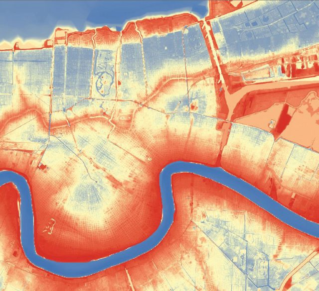 A LIDAR digital elevation model of a ten-mile-by-ten-mile area of New Orleans, captured in 2000, shows above-sea-level areas in red and lower areas in yellow and blue shades. Courtesy State of Louisiana and FEMA
