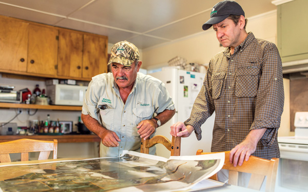 Audubon's Timmy Vincent (left) and Doug Meffert at the Rainey Sanctuary camp. Photo by Zack Smith