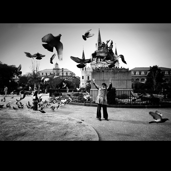 Tennessee Williams scaring pigeons in Jackson Square, New Orleans, La. 1977
